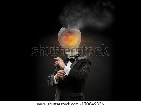 Businessman with exploded overworked lamp head on black backgrou Stock photo © hasloo