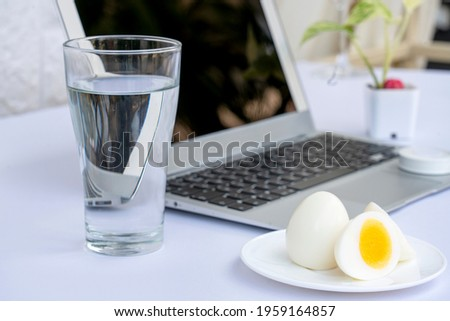 Glass of milk with boiled egg and tape Stock photo © jenbray