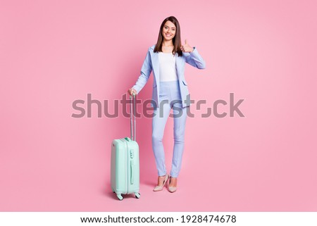 Businesswoman holding suitcase and showing thumb-up. Dilapidated brick wall, green meadow with sky a Stock photo © cherezoff