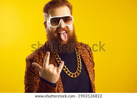 young man in leopard print looking at the camera in studio backg stock photo © feedough