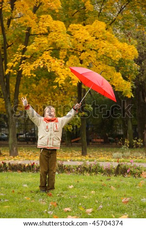 portrait of boy in autumn park hands are lifted in one red umbrella stock photo © paha_l