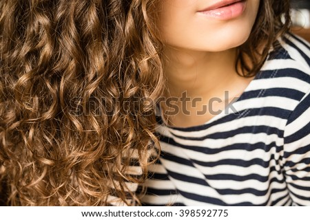 attractive woman with beautiful long curly hair in pink sunglasses stock photo © deandrobot