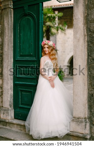 tender charming bride in rose wreath with bouquet of flowers stock photo © deandrobot