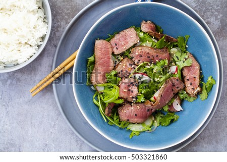 Tasty dish of roast beef with rice and salad leaves and a glass  Stock photo © vlad_star