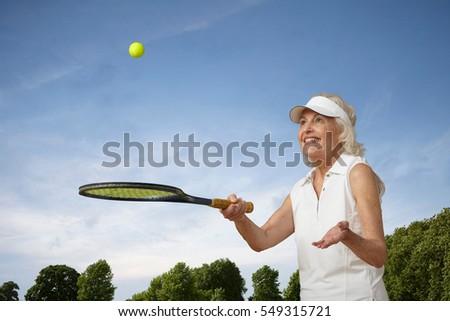 golflabda · nő · tart · klub · golf · jókedv - stock fotó © dash