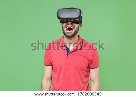 Screaming emotional bearded man wearing virtual reality device Stock photo © deandrobot