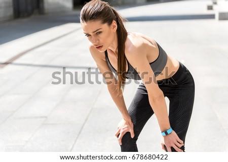 Young beautiful the female athlete trains at stadium in summer d Stock photo © Yatsenko