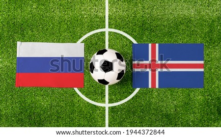 Iceland vs. Russia flags on soccer field Stock photo © kb-photodesign
