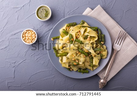 Italian fettuccine with green beans and parmesan on a dark woode Stock photo © Yatsenko