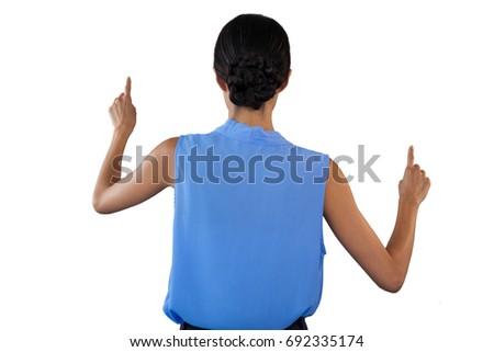 Hátsó nézet üzletasszony ujjatlan ruházat mutat interfész Stock fotó © wavebreak_media