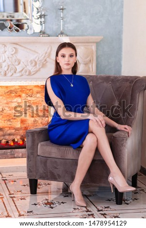 beauty young brunette woman sitting near fireplace at home, winter warm evening in interior, waiting Stock photo © iordani