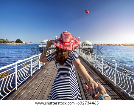 Follow me - happy young woman in a red hat and with a backpack b Stock photo © vlad_star