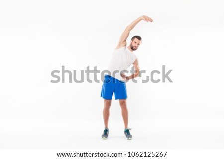 Full length portrait of a concentrated sportsman doing stretching Stock photo © deandrobot