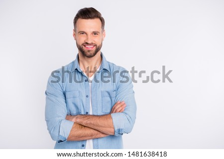 Stock photo: Portrait of young handsome confident guy with hands on his jacket on yellow background