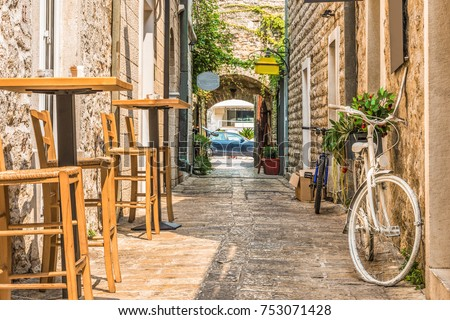 Old stone houses with windows with shutters in Budva in Monteneg Stock photo © bezikus