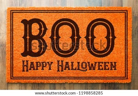 Boo, Happy Halloween Orange Welcome Mat On Wood Floor Background Stock photo © feverpitch
