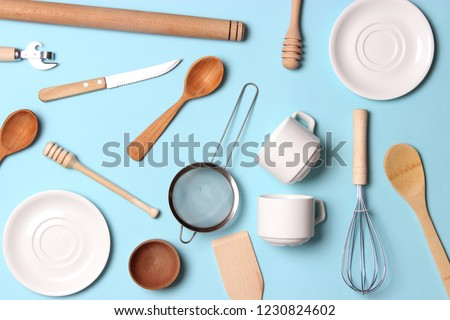 Set of kitchen tools knife, whisk, sieve and spoon on black concrete background with copy space. Top Stock photo © artjazz