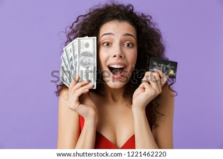 image of delighted woman 20s wearing red dress holding fan of mo stock photo © deandrobot