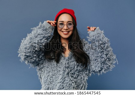 Studio portrait of stylish pretty positive brunette girl showing gesture of good and super by big fi Stock photo © studiolucky
