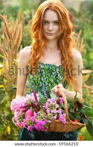 Woman with red hair holds beautiful colourful blossoming flower bouquet of fresh roses living coral  Stock photo © artjazz