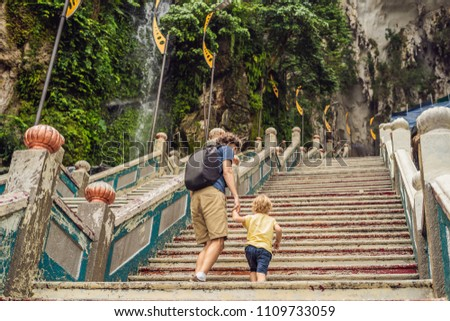 Father and son in the background of Batu Caves, near Kuala Lumpur, Malaysia. Traveling with children Stock fotó © galitskaya