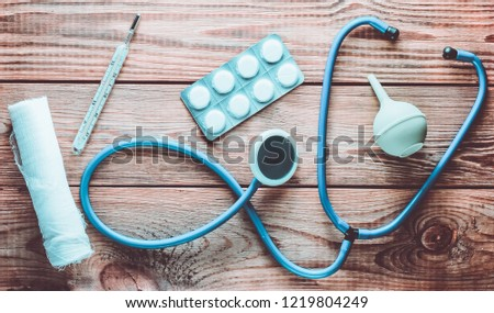 Stock photo: View of stethoscope, drug and equipment on foreground table, Hea