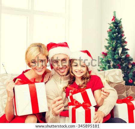 幸せ · 女性 · サンタクロース · 帽子 · ギフト · 花火 - ストックフォト © dashapetrenko