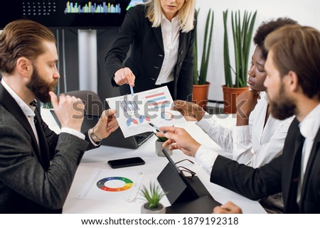 Confident businesswoman pointing at tablet screen during presentation of ideas Stock photo © pressmaster