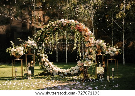 Decoration wedding arch with white and pink flowers on a green natural background. Stock photo © ruslanshramko