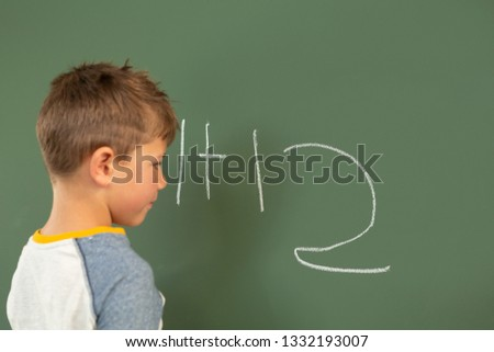 Vista lateral bonitinho caucasiano estudante matemática verde Foto stock © wavebreak_media