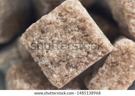 Close-Up shot of natural brown unrefined sugar cubes on white background. Stock photo © DenisMArt
