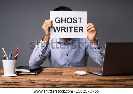 Businessman Hiding His Face Behind Card With Ghost Writer Text Stock photo © AndreyPopov