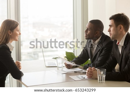 Side view of diverse business people listening attentively while attending a business seminar in off Stock photo © wavebreak_media