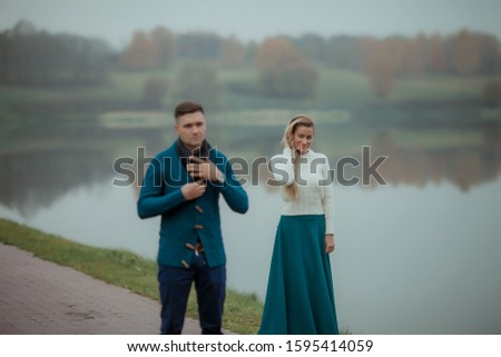 A couple of two a strong man and an elegant woman recently married on their honeymoon Stock photo © ElenaBatkova