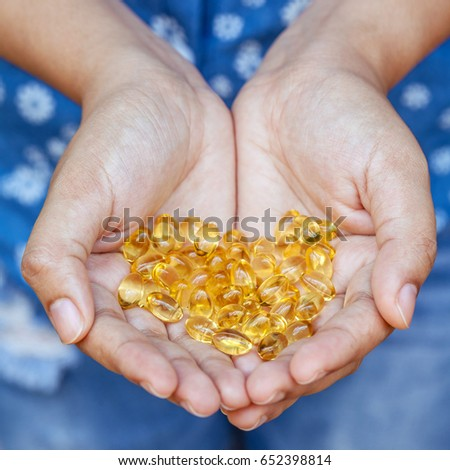 Fish oil capsules source of high omega-3 and vitamin for health  Stock photo © marylooo