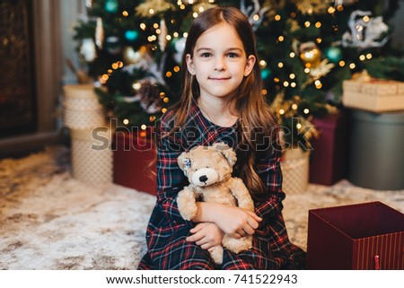 Small female child with appealing appearance, holds teddy bear,  Stock photo © vkstudio