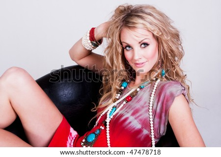 Horizontal shot of cheerful woman with dyed hair, toothy smile, chats online via smartphone, uses ap Stock photo © vkstudio
