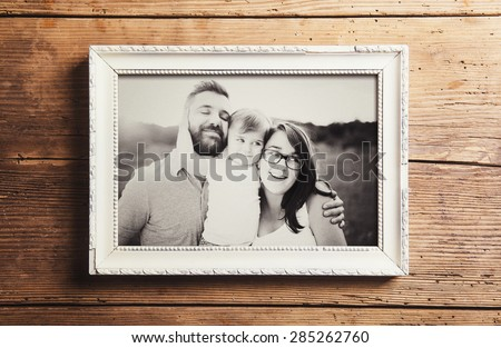 Woman on black and white, holding a decorative frame and standing inside it with thumb up, studio sh Stock photo © alexandrenunes