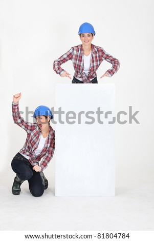 young female duo wearing blue safety helmet against white background Stock photo © photography33