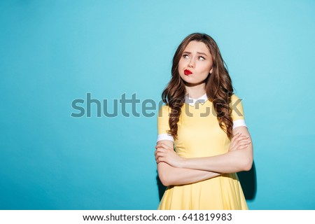 Portrait of the offended beauty young woman. Isolated on white Stock photo © acidgrey