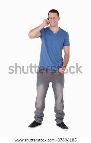 Portrait of a smiling man making a phone call against a white background Stock photo © wavebreak_media