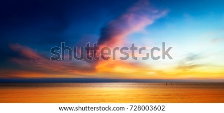 beautiful seascape with orange warm sunrise stock photo © zhukow