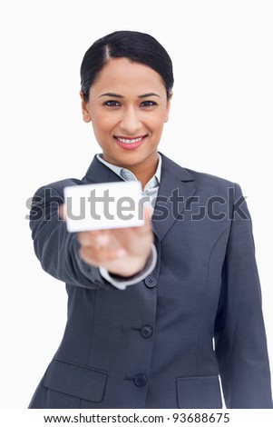 close up of smiling saleswoman showing her business card against a white background stock photo © wavebreak_media