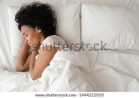 Stock photo: woman sleeping peacefully