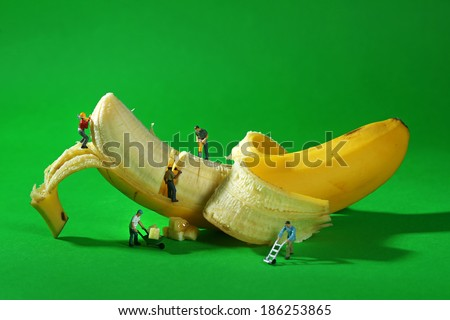 Stock photo: Miniature Construction Workers in Conceptual Food Imagery With C