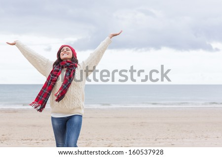 Young woman in warm clothing and standing with her arms akimbo Stock photo © bmonteny