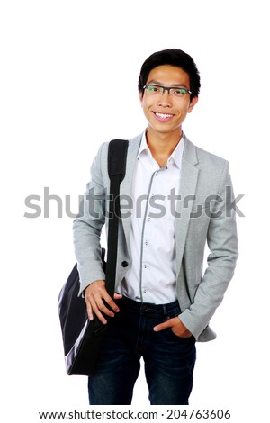 portrait of a happy asian man standing with briefcase over white background stock photo © deandrobot