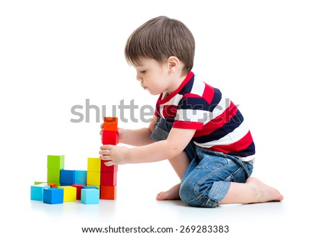 Little cute boy playing with building blocks. Isolated on white. Stock photo © Photoline