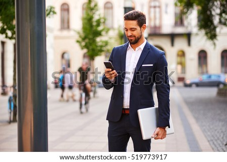young business man working with his laptop and calling on cellph stock photo © hsfelix