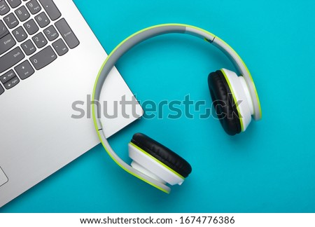 Wireless headphones on laptop keyboard. Music and gaming concept Stock photo © simpson33